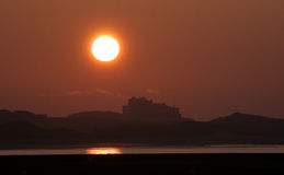 Sunset over Bamburgh Castle Stock Photography