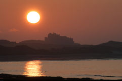 Sunset over Bamburgh Castle Stock Photo