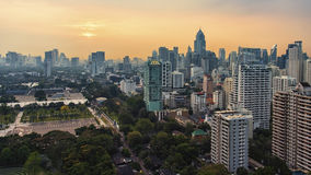 Sunset over Banjakiti park in Bangkok Royalty Free Stock Image