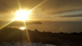 Sunset over the bank of Newfoundland royalty free stock photo