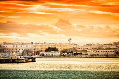 Sunset over Bari. City in Italy seen from the harbour Stock Photography