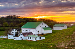 Sunset over a barn and farm fields in rural York County, Pennsyl Stock Photo