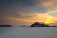 Sunset over a Barn Royalty Free Stock Images