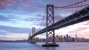 Sunset over San Francisco-Oakland Bay Bridge and San Francisco Skyline, California Royalty Free Stock Photos