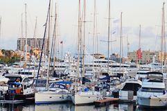 The bay with yachts is surrounded by low hills. Stock Photography