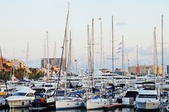 The bay with yachts is surrounded by low hills. Stock Image