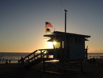 Sunset over baywatch tower in California Royalty Free Stock Photos