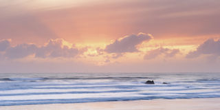 Sunset over beach. Scenic view of sunset over Widemouth Bay beach, Cornwall, U.K stock photos
