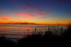 Sunset over the beach Stock Photos