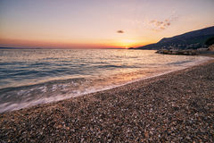 Sunset over the beach Royalty Free Stock Photo