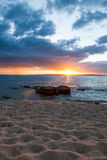 Sunset over the beach. Beautiful picture taken on Groote Eylandt in the Northern Territory in Australia.  The sun is right above the ocean line and create a Royalty Free Stock Photography