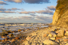 Sunset over the beach and cliffs in Wolinski National Park, Balt Royalty Free Stock Image