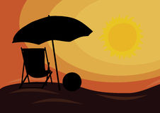 Sunset over the beach with deck chair Royalty Free Stock Photography