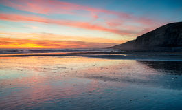 Sunset over the beach at Dunraven Bay. Near Bridgend in Wales Royalty Free Stock Photos