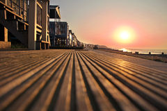 Sunset over beach huts. Photo of the setting sun going down over beach huts on the whitstable coast of kent stock image