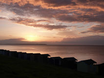 Sunset over beach huts at Whitstable Royalty Free Stock Photos