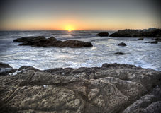 Sunset over beach at Leo Carillo Stock Photos
