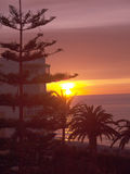 Sunset over the beach in Nerja on the Eastern End of the Costa del Sol in Spain Royalty Free Stock Photo
