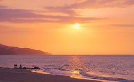 Sunset over beach, Playa San Luis, Venezuela. Orange skies at sunset over waves on sandy beach at Playa San Luis, Venezuela royalty free stock photo