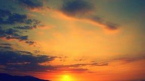 Sunset over beach, Playa San Luis, Venezuela. Orange skies at sunset over waves on sandy beach at Playa San Luis, Venezuela royalty free stock photography