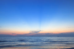 Sunset over the beach and sea Royalty Free Stock Photo