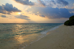 Sunset over beach of Ukulhas in the Indian ocean, Maldives Stock Images