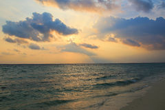 Sunset over beach of Ukulhas in the Indian ocean, Maldives Royalty Free Stock Image