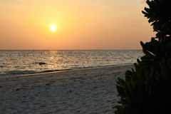 Sunset over beach of Ukulhas in the Indian ocean, Maldives Royalty Free Stock Photos