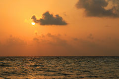 Sunset over beach of Ukulhas in the Indian ocean, Maldives Stock Photo