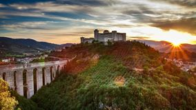 Sunset over beautiful castle in Preci, Italy stock video