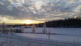 Sunset over beautiful snow covered field Stock Images