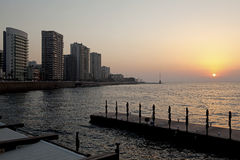Sunset over Beirut. The sun setting over the sea and Beirut city Royalty Free Stock Images