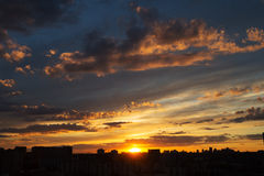 Sunset over big city with amazing clouds Royalty Free Stock Photography