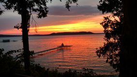 Sunset over Big Glen Lake from Settler`s Park. Near to Sleeping Bear Dunes National Lakeshore Stock Images