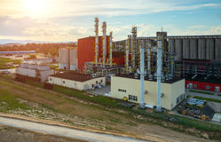 Sunset over biofuel factory. Beautiful sunset over the modern biofuel factory stock images