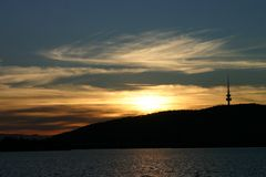 Sunset over Black Mountain. A sunset of Black Mountain with high cloud, and Lake Burley Griffin Stock Photography