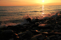 Sunset over the Black sea and summertime beach Royalty Free Stock Photo