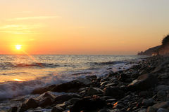 Sunset over the Black sea and summertime beach Stock Image