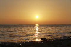 Sunset over the Black sea and summertime beach Royalty Free Stock Images