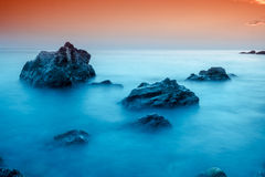 Sunset over Blue Bay Stock Photography