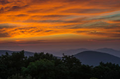 Sunset Over Blue Ridge Parkway. The sky turns brilliant orange and purple as the sun sets over the Blue Ridge Mountains in Virginia stock photography