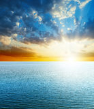 Sunset over blue sea. Bright sunset over blue sea Royalty Free Stock Photo