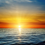 Sunset over blue sea Royalty Free Stock Image