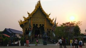 Sunset over the Blue Temple, Chiang Rai, Thailand. CHIANG RAI, THAILAND - MAY 10, 2019: Sunset over amazing viharn of Wat Rong Seua Ten Blue Temple, decorated stock video footage