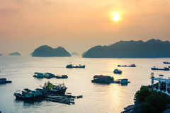 Sunset over boats of Cat ba island in Vietnam Stock Photos