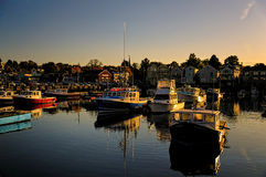 Sunset over boats in harbor Royalty Free Stock Images