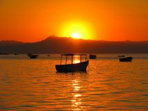 Sunset over boats on Lake Malawi Stock Photography
