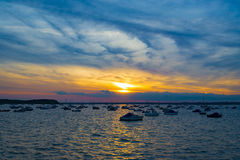 Sunset over Boats in Poole Harbour Royalty Free Stock Photography
