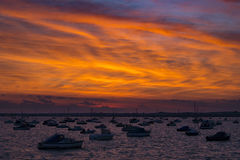 Sunset over Boats in Poole Harbour Royalty Free Stock Images