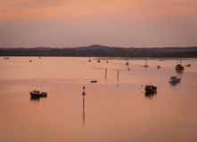 Sunset over Boats in Poole Harbour Stock Image